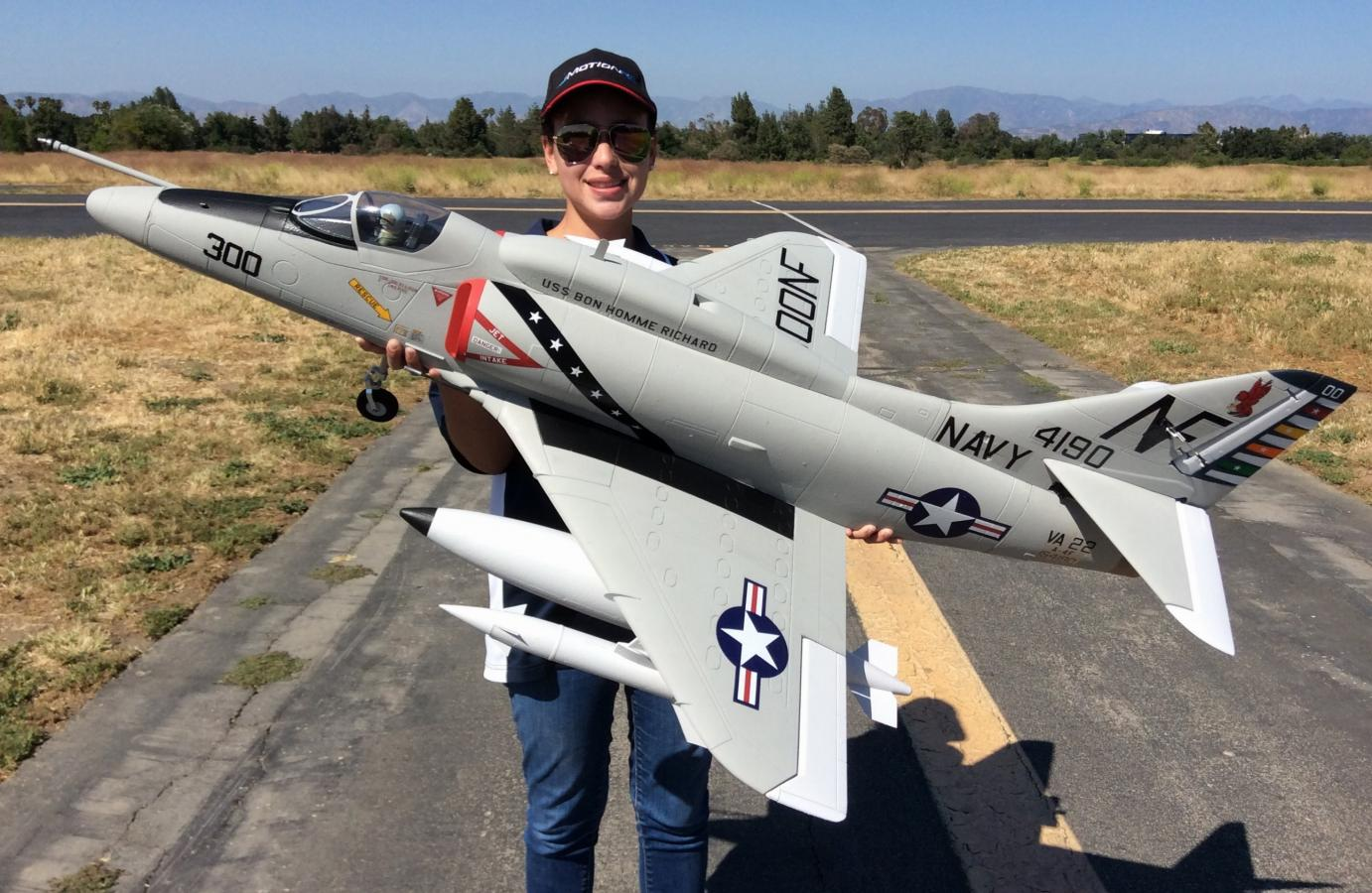 RC Pilot Evelyn holding the new Freewing 80mm A-4 E/F Skyhawk.