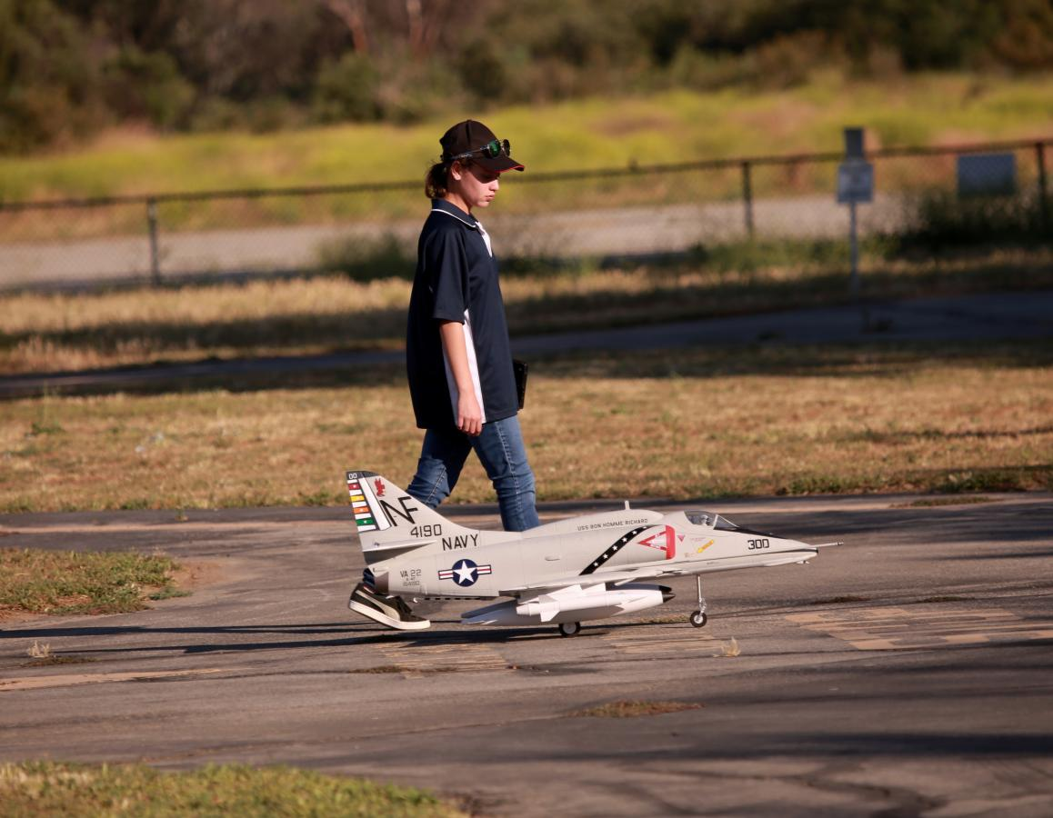 Evelyn walking with her new favorite Freewing jet.
